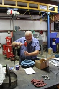 Richard West, pump service, works on a bearing housing for one of two Flygt 4430 banana blade mixers he was rebuilding.