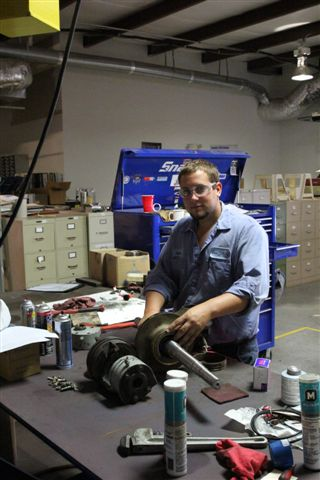Dustin Foster works on a pump repair.