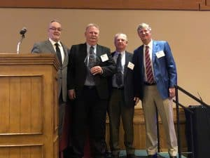 David Steblein presents Tim Weber with the Distributor eagle Award, with Henry Ritchie and Ed Pearce